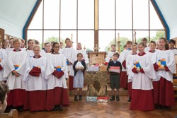 Young boy and girl with choir at Harvest Festival